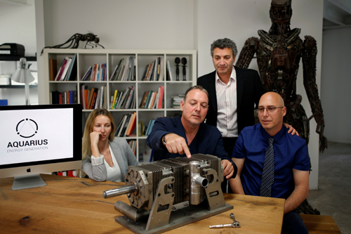Yaakoby, CTO and Inventor, Fridman, Chief Marketing Officer, Gonik, Head of Business Development and Gorfung, Chief Executive Officer from Israeli start-up Aquarius Engines pose for a picture next to a prototype of their combustion engine at their offices